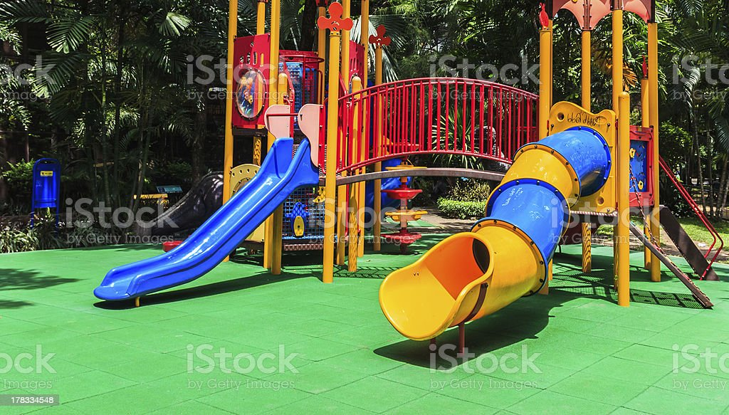 Colorful Playground with Green Elastic Rubber Floor for Children in...