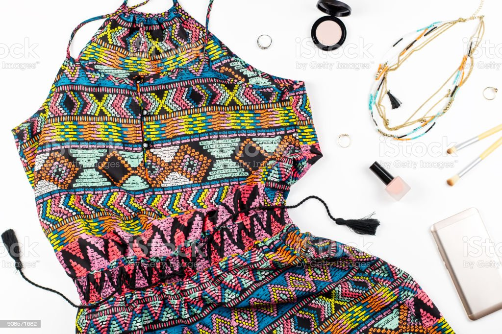 Colorful playsuit, make up products and accessories on white background. stock photo
