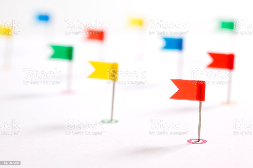 Colorful pointing flags stock photo