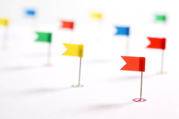 Colorful pointing flags - Photo