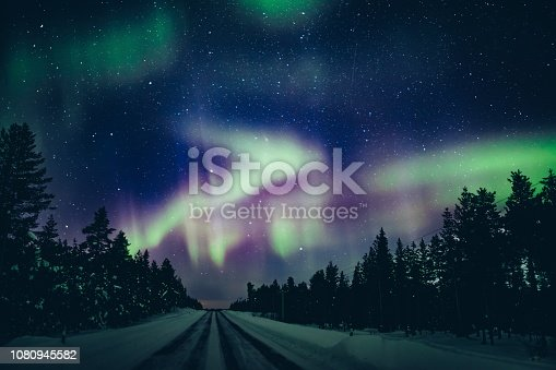 istock Colorful polar arctic Northern lights Aurora Borealis activity in winter Finland 1080945582