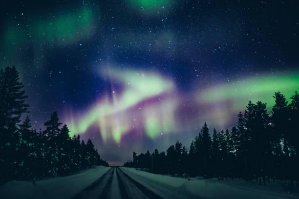 Colorful polar arctic Northern lights Aurora Borealis activity in winter Finland stock photo