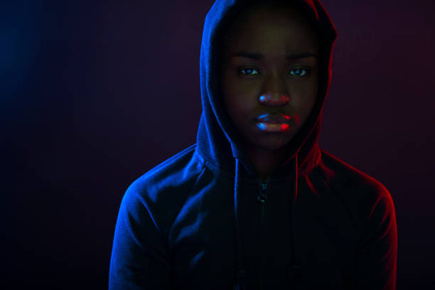 Colorful portrait of a cool woman with dark skin wearing hoodie stock photo