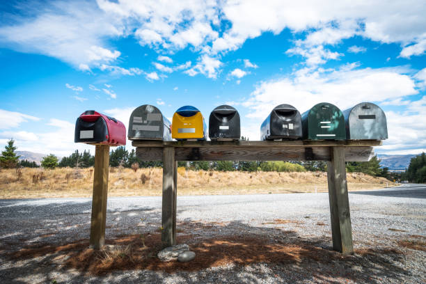 colorful post boxes near road colorful post boxes near road letterbox format stock pictures, royalty-free photos & images