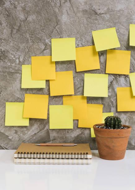 colorful post it,memo notebook,pencil,cactus in flowerpot on white desk concrete background,work space concept - post it notes zdjęcia i obrazy z banku zdjęć