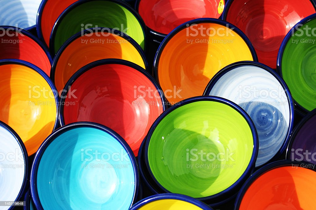 Colorful pottery bowls in the sun royalty-free stock photo