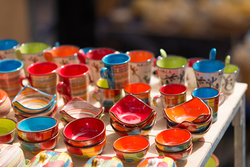 colorful pottery dishes on market stall - Spanish pottery