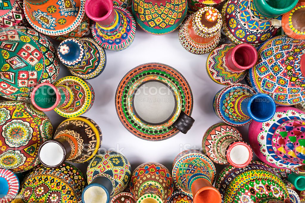 Colorful pottery vases compacted in a circle around single vase stock photo