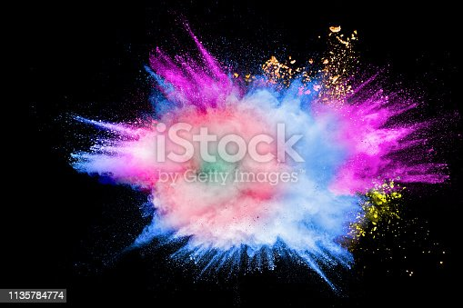 1131535585 istock photo Colorful powder explosion in Happy Holi Festival. Multicolored dust particle splashing. 1135784774