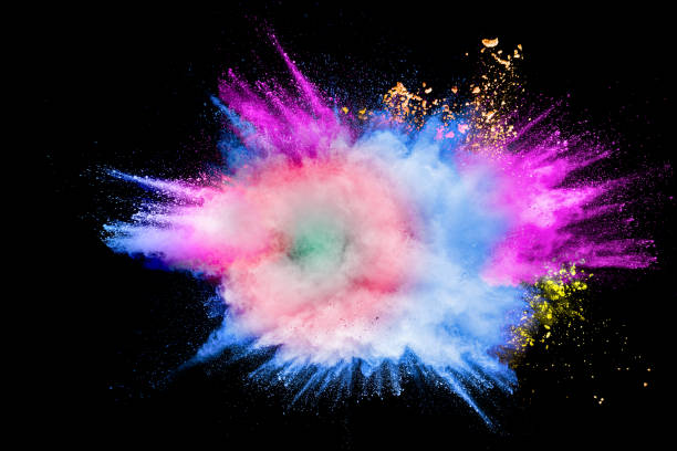 Colorful powder explosion in Happy Holi Festival. Multicolored dust particle splashing. Colorful powder explosion in Happy Holi Festival. Multicolored dust particle splashing. colored powder stock pictures, royalty-free photos & images