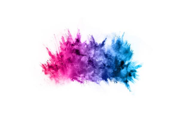 colorful powder explosion on white background. - cores imagens e fotografias de stock