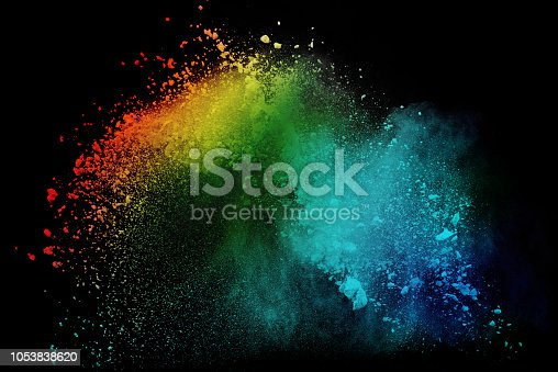 Colorful powder or dust explosion isolated on black background  freeze stop motion art abstract photo object design
