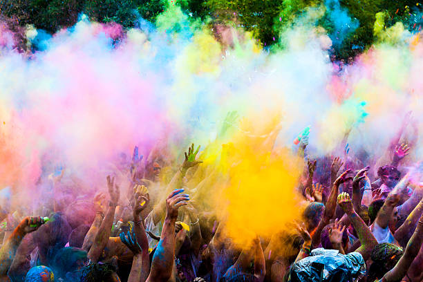 Colorful powder throw at a holi party - Photo