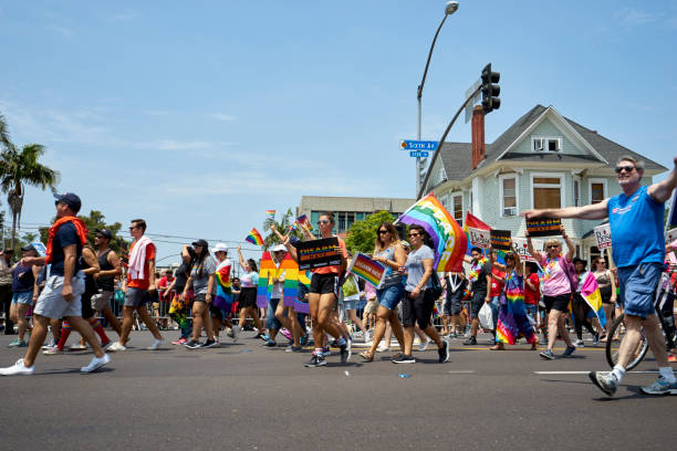 colorful Pride Parade participants and spectators supporting the LGBT community in Hillcrest stock photo