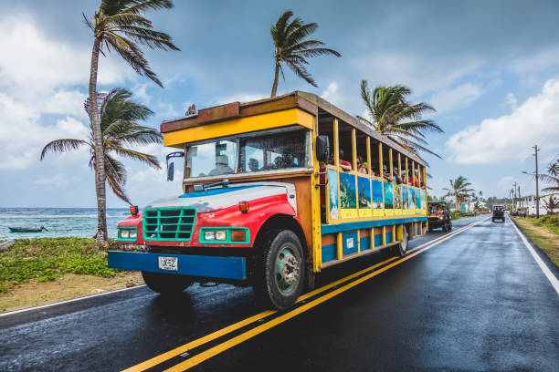 Colorful Public Transportation Bus doing the Round Trip All Around the Island. All kind of Vehicles use this Route stock photo