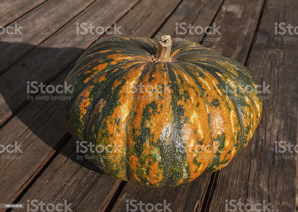 colorful pumpkin on a wood table royalty-free stock photo