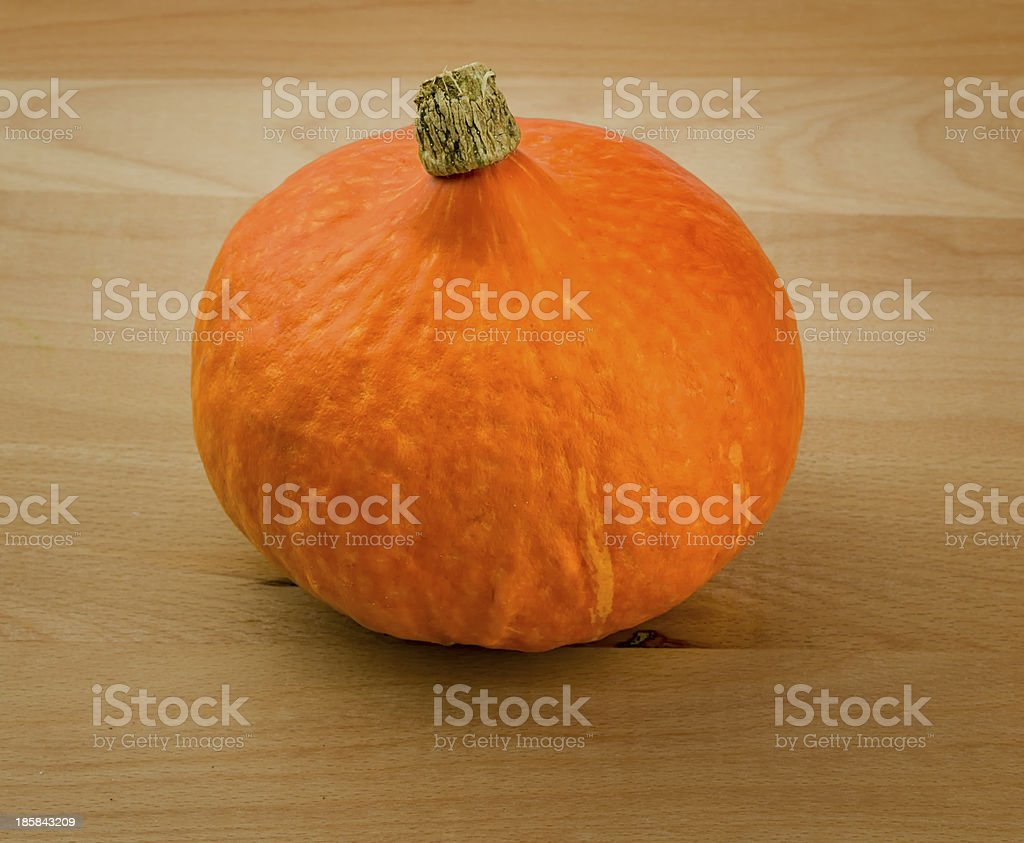 Colorful Pumpkin on Wooden Cutting Board royalty-free stock photo