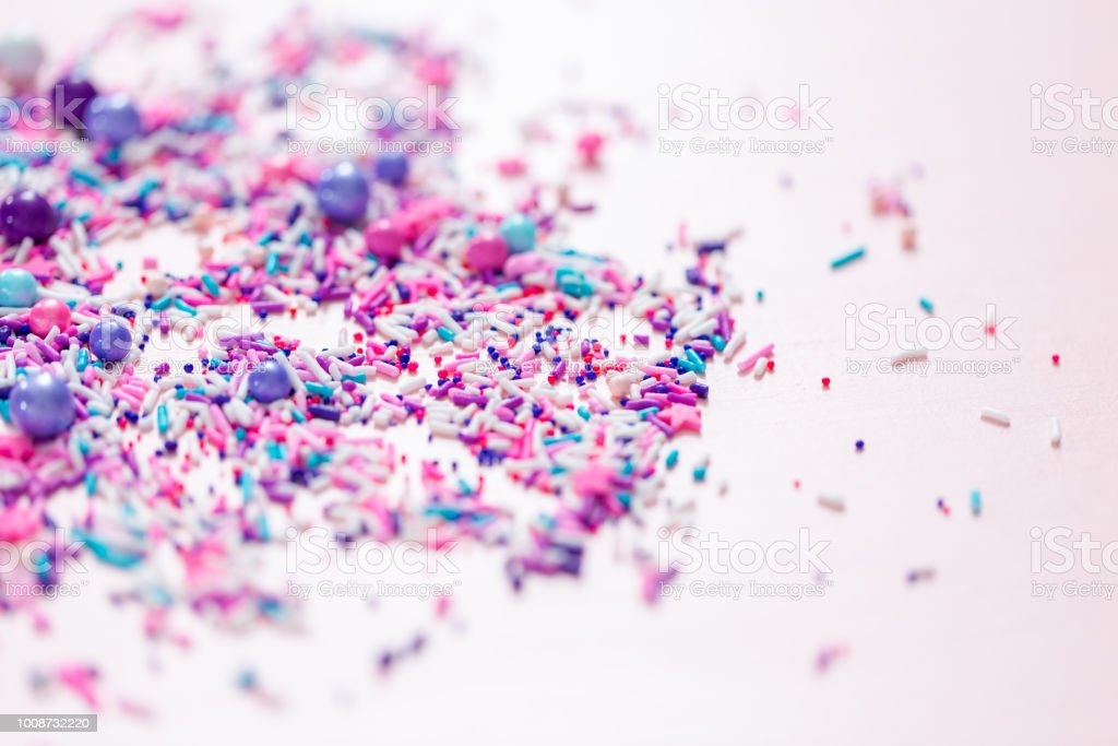 Colorful Purple Sprinkle Blend On A Pink Background Stock