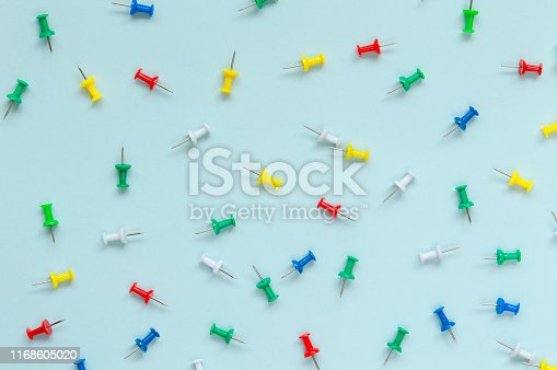 Colorful Push Pins on blue background