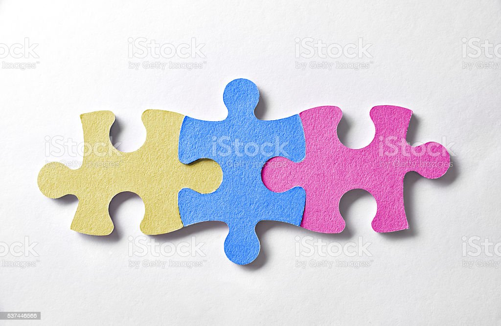 Colorful puzzle pieces aligned and bonded stock photo