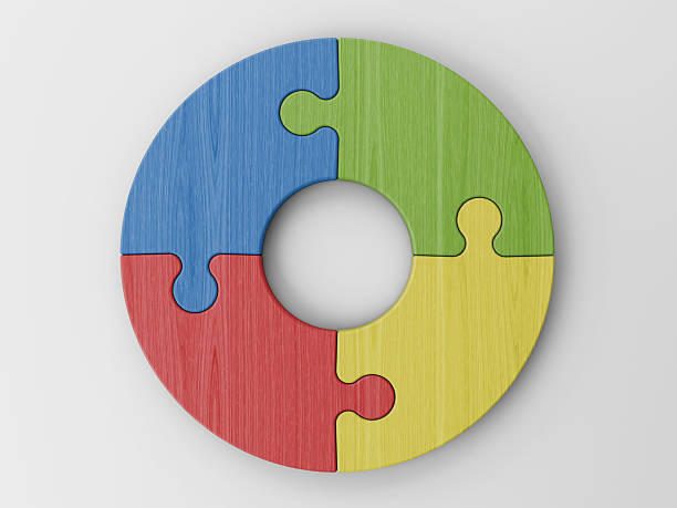 Colorful puzzle pieces forming a circle stock photo