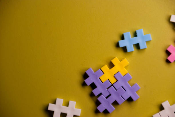 colorful puzzle pieces on top of a green desk - foto stock