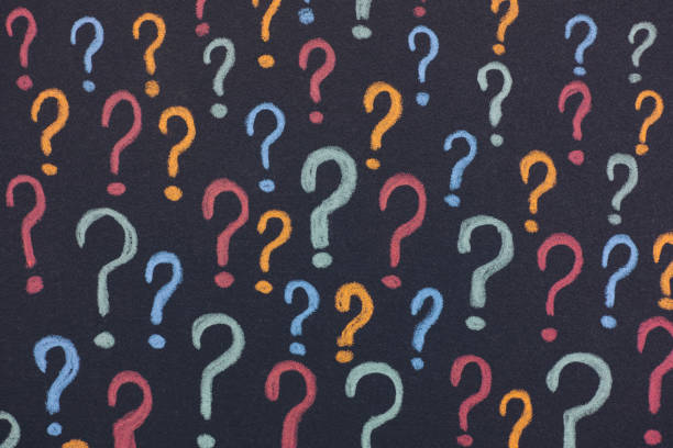 Colorful question marks on a black background stock photo