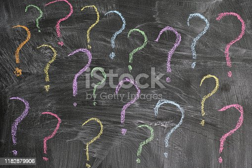Colorful question marks on a blackboard. Close up.