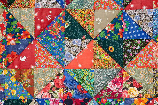 colorful quilt background - quilt stock photos and pictures