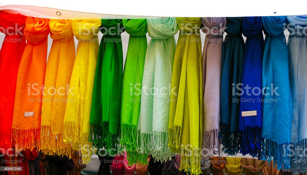 Colorful rainbow of pashmina scarves royalty-free stock photo
