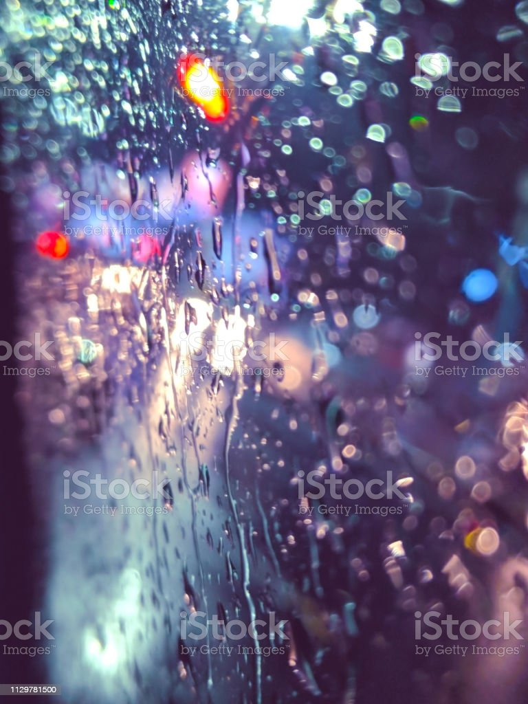 Colorful Rainwater Drops On Window With Road Light Bokeh Background Stock Photo Download Image Now