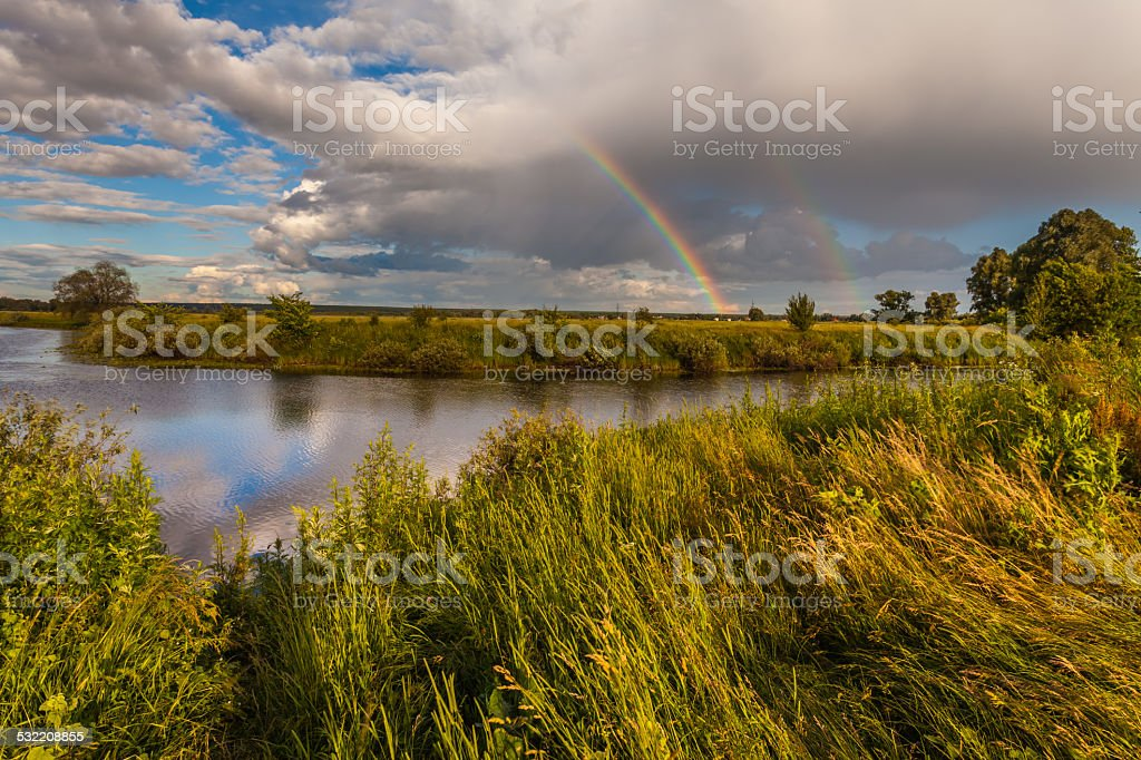 colorful Ranibow over the falls and water stock photo