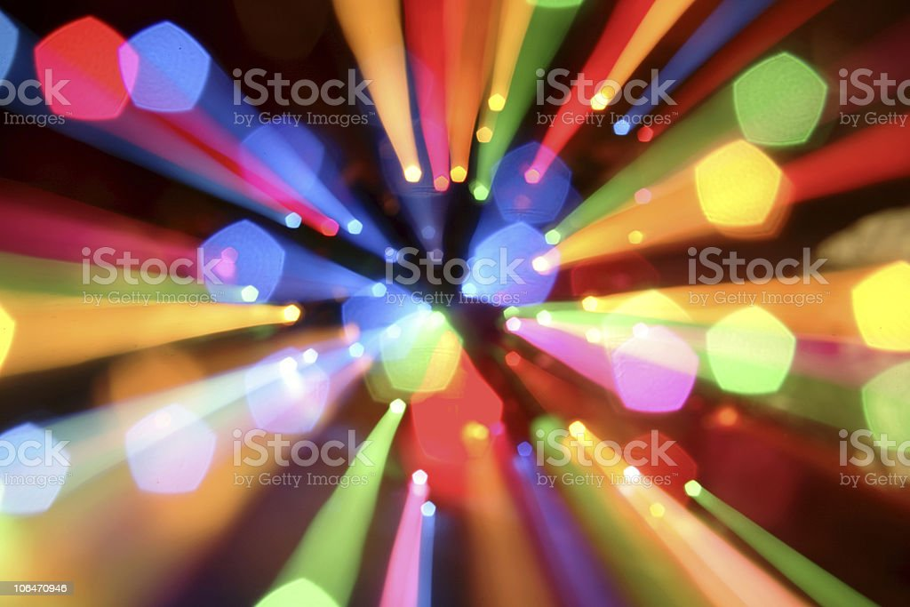 Colorful ray of lights that passes through several holes royalty-free stock photo
