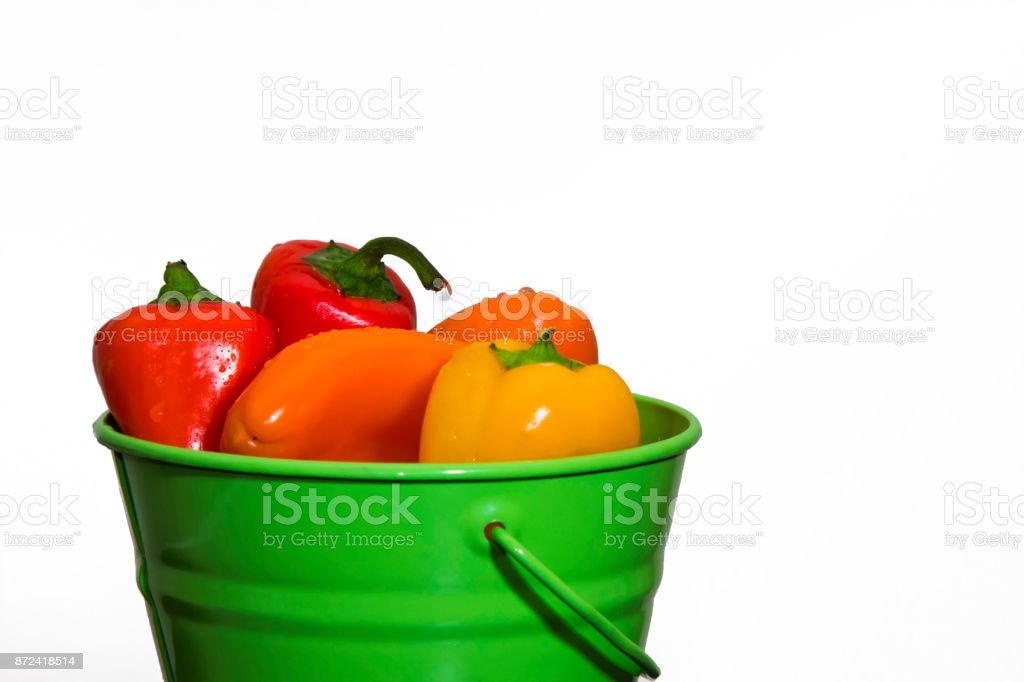 Colorful red, orange and yellow capsicums on a white background.  Healthy eating background. Food photography. stock photo