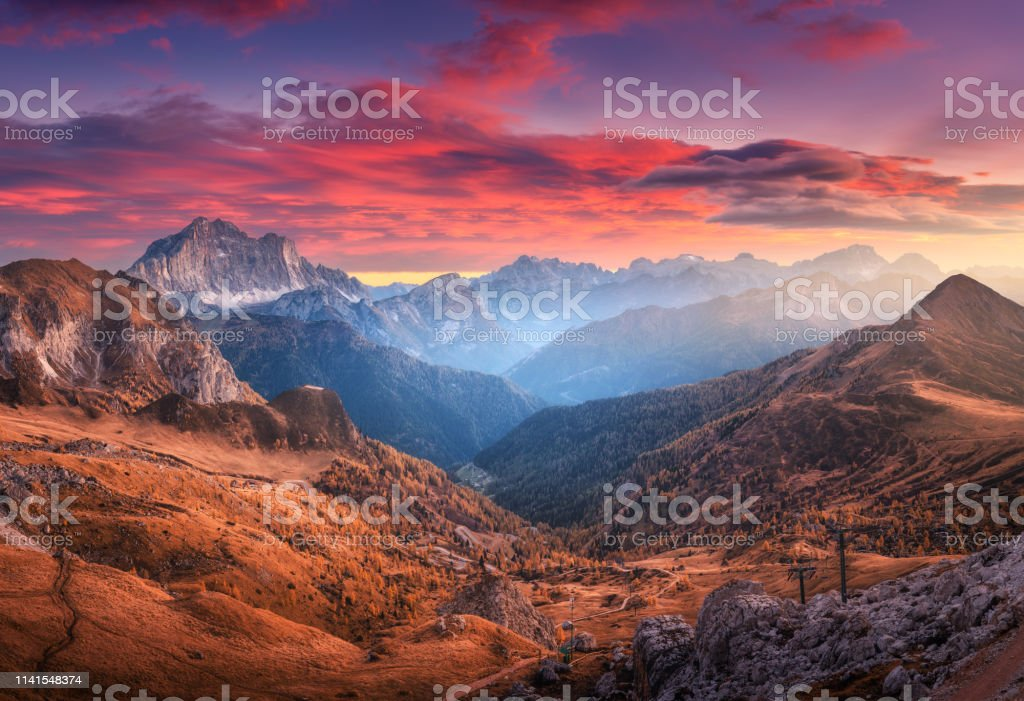 Colorful Red Sky With Clouds Over The Beautiful Mountains In