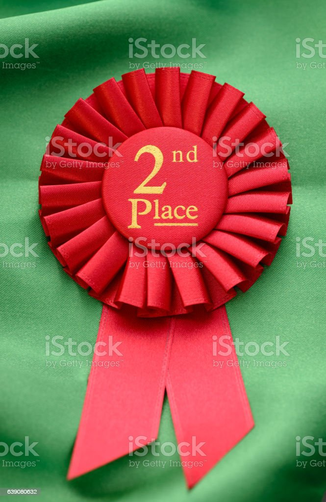 Colorful red winners 2nd place rosette stock photo