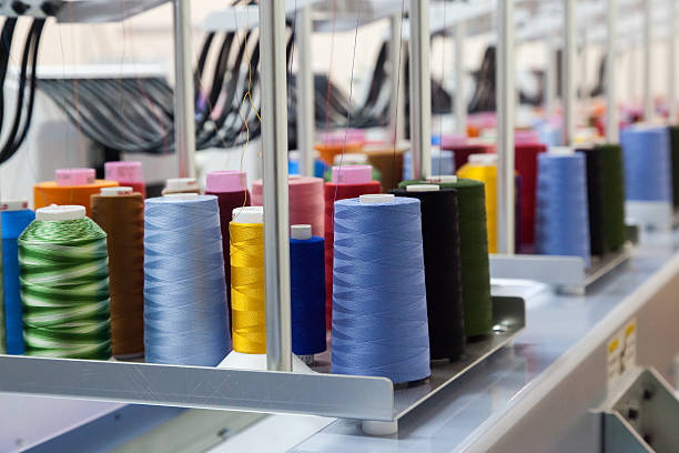 colorful reels of threads background - embroidery machine stock pictures, royalty-free photos & images