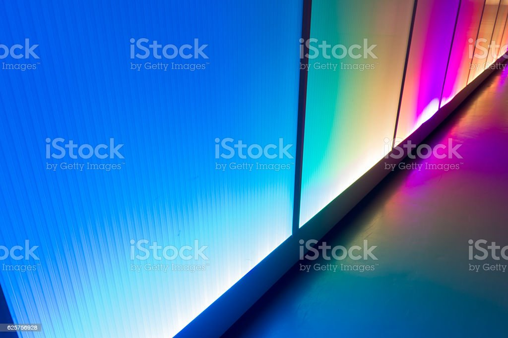 Colorful reflection of the lighting wall background stock photo