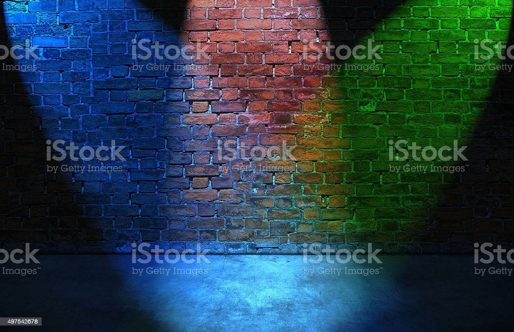 Colorful RGB spot lights on brick wall stock photo