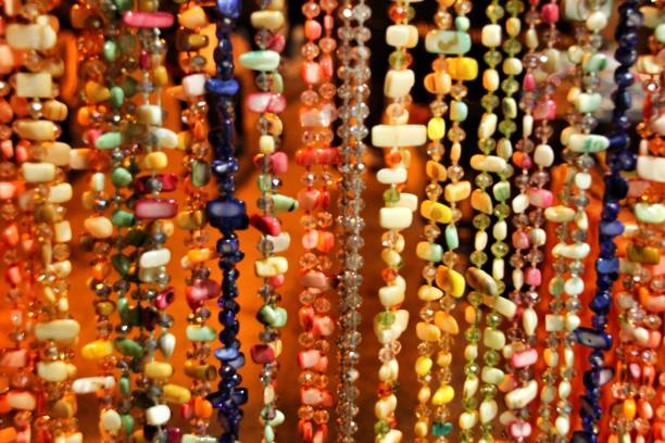 Colorful rhinestones necklaces hanging in a street stall – zdjęcie