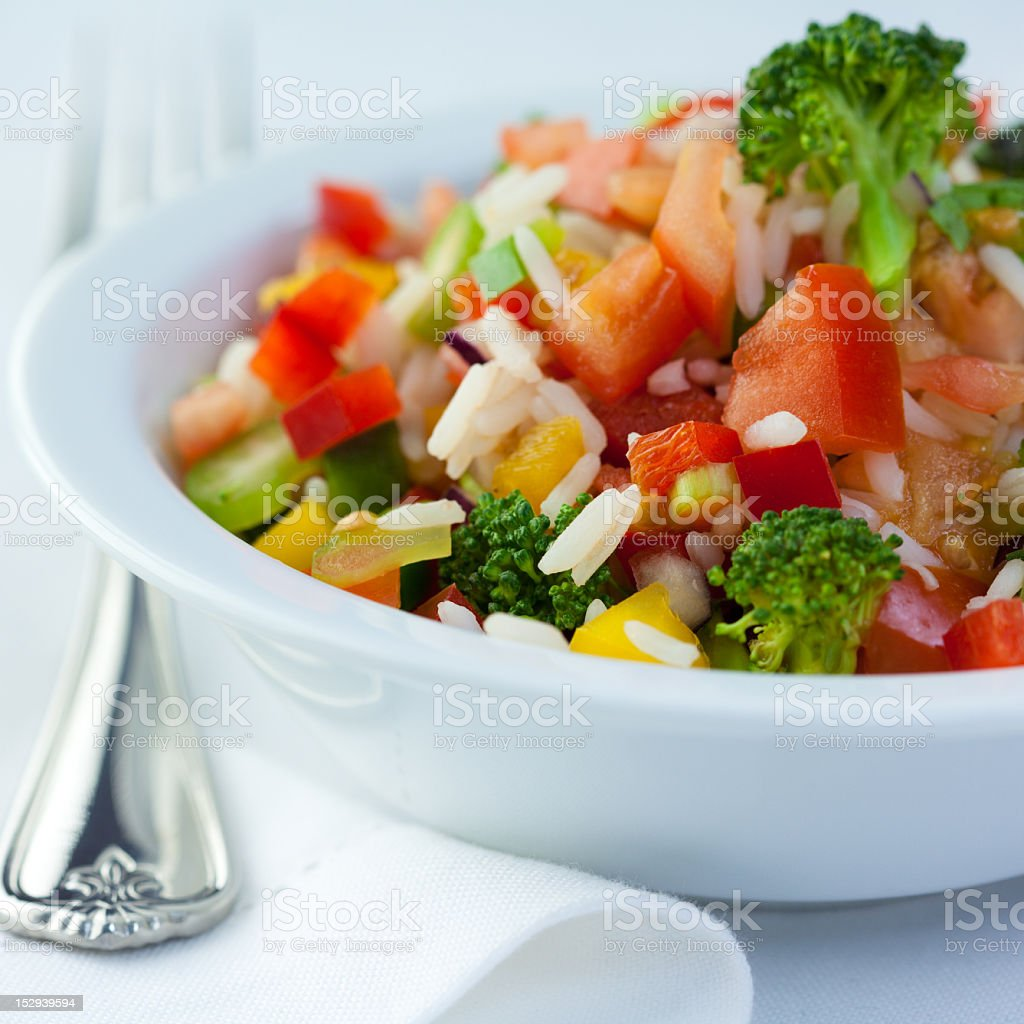 Colorful rice and vegetable salad stock photo