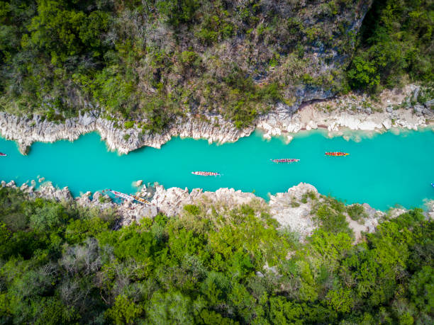 colorful river top shot aerial colorful river of Tamul, Mexico. san luis potosi stock pictures, royalty-free photos & images