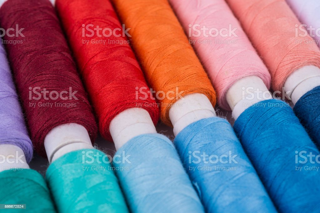 colorful rolls of yarn, sewing thread stock photo