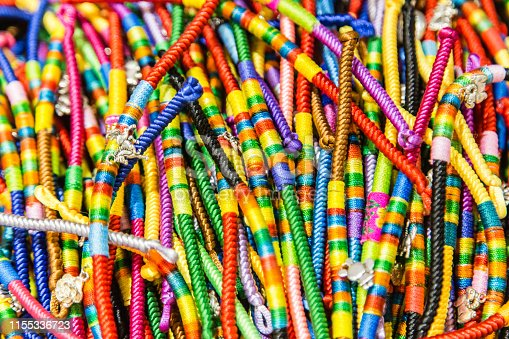 532522827istockphoto colorful rope for celebrate Chinese festival background view 1155336723