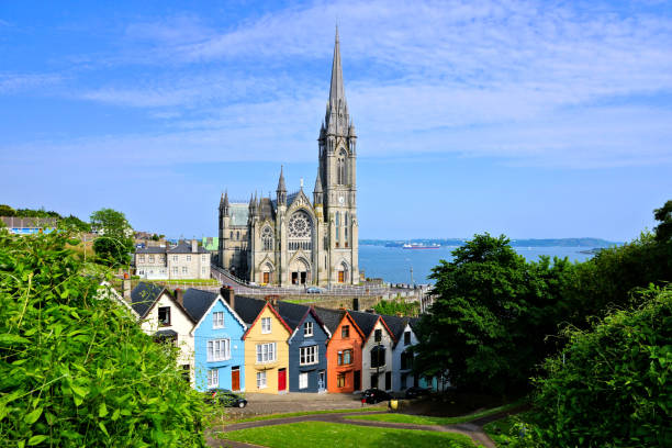 Colorful row houses with cathedral in background, Cobh, County Cork, Ireland stock photo