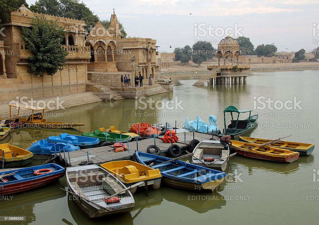 colorful rowboats moored on the lake at Gadi Sagar stock photo