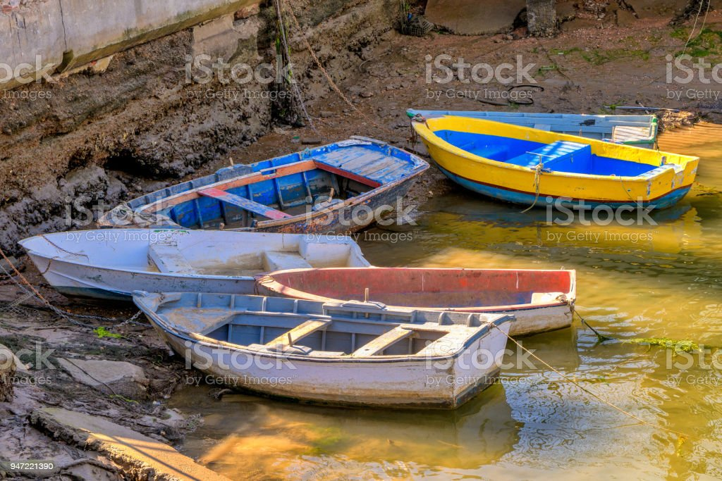 Colorful rowboats on the shore. stock photo