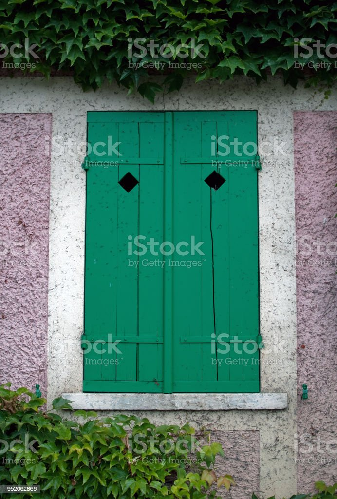 Colorful, rustic window shutters. stock photo