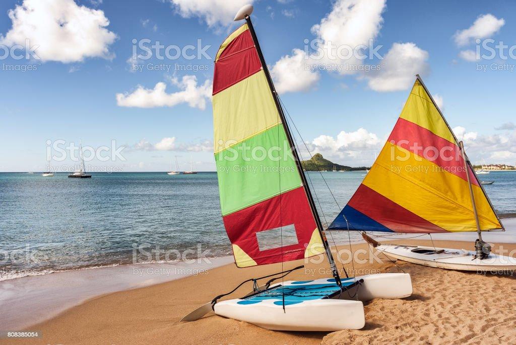 Colorful Sailboat And Kayak On Sandy Beach Stock Photo