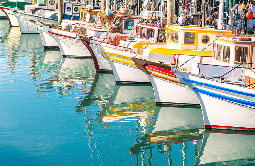 Colorful sailing boats at Fishermans Wharf of San Francisco Bay